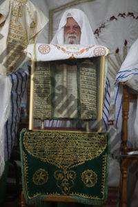 The Late High Priest, Aharon son of Ab Hisada With the scroll of Abisha.